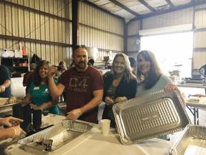 From left to right: Jeremy, Joanie, and Andrea representing PMIS at the Lakeland CarBQ